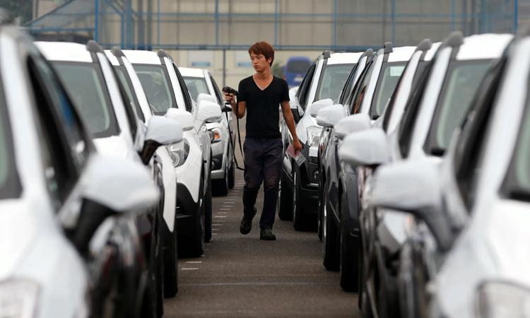 Công nhân của GM Hàn Quốc, hãng đóng cửa một trong ba nhà máy tại Hàn năm ngoái. Ảnh: Reuters.