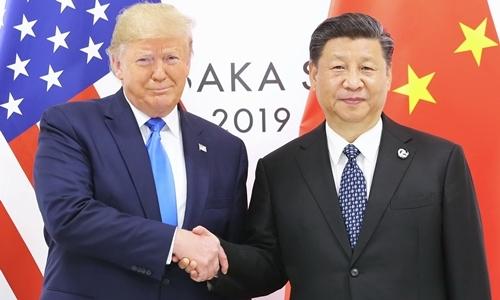 Tổng thống Mỹ Trump (trái) và Chủ tịch Trung Quốc Tập Cận Bình ngày