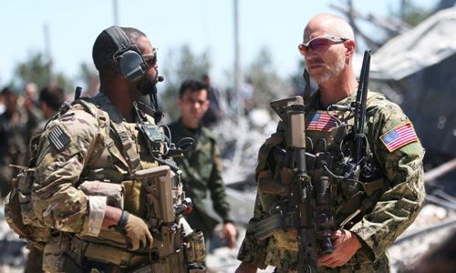 Lính Mỹ tại một trụ sở của dân quân người Kurd ở thành phố Malikiya, Syria hồi tháng 4/2017. Ảnh: Reuters.