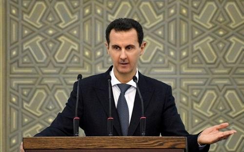 Tổng thống Syria Bashar al-Assad phát biểu tại cuộc họp với các lãnh đạo hội đồng địa phương ở Damascus hồi tháng hai. Ảnh: Reuters.