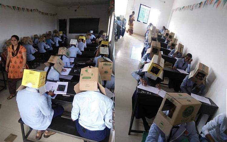 Các học sinh đội thùng carton trong giờ kiểm tra. Ảnh: Ani   Twitter