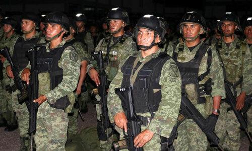 Các thành viên lực lượng đặc nhiệm Mexico tại thành phốCuliacan hôm 21/10. Ảnh: Reuters.