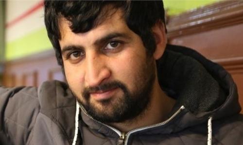Jawad Amiri, người từng suýt chết ngạt vì trốn trong xe container để vào Anh. Ảnh: BBC.