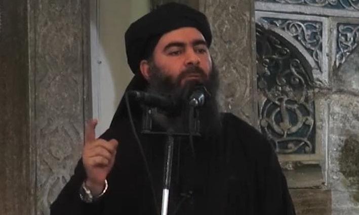 Thủ lĩnh tối cao IS Abu Bakr al-Baghdadi tại một nhà thờ ở Mosul, Iraq hồi tháng 7/2014. Ảnh: AFP.