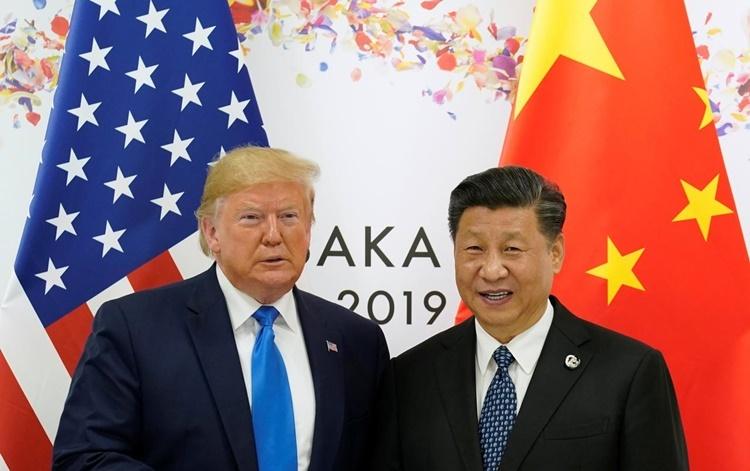 Tổng thống Mỹ Donald Trump (trái) và Chủ tịch Trung Quốc Tập Cận Bình tại hội nghị thượng đỉnh G20 ở Nhật Bản hồi tháng 6. Ảnh: Reuters.