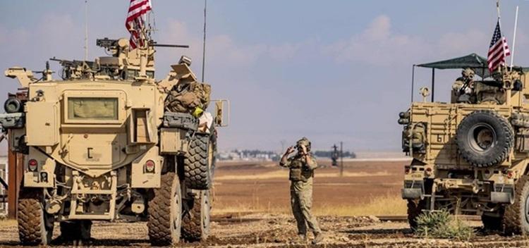 Xe bọc thép Mỹ tuần tra ở thị trấn Qahtaniyah, phía bắc Syria hôm nay. Ảnh: AFP.