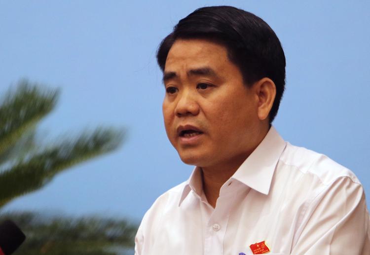 Ông Nguyễn Đức Chung phát biểu tại phiên giải trình HĐND TP Hà Nội sáng 4/11. Ảnh: Võ Hải.