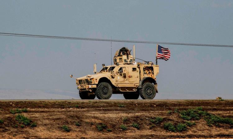 Xe quân sự Mỹ di chuyển ở đông bắc Syria hồi đầu tháng 11. Ảnh: AFP.