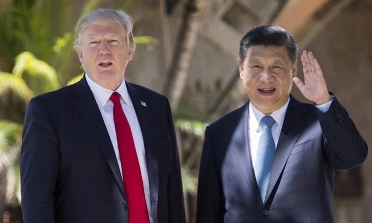 Tổng thống Mỹ Trump (trái) và Chủ tịch Trung Quốc Tập Cận Bình tại Mỹ năm 2017. Ảnh: AFP.