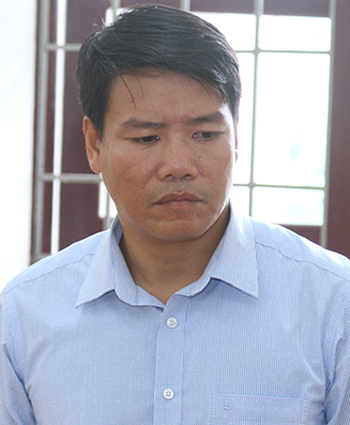 Ông Nam thời điểm bị bắt. Ảnh: Quang Văn