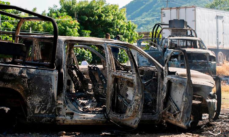 Hiện trường vụ phục kích khiến 13 cảnh sát thiệt mạng tại thị trấn El Aguaje, bang Michoacan, Mexico hôm 14/10. Ảnh: AFP.