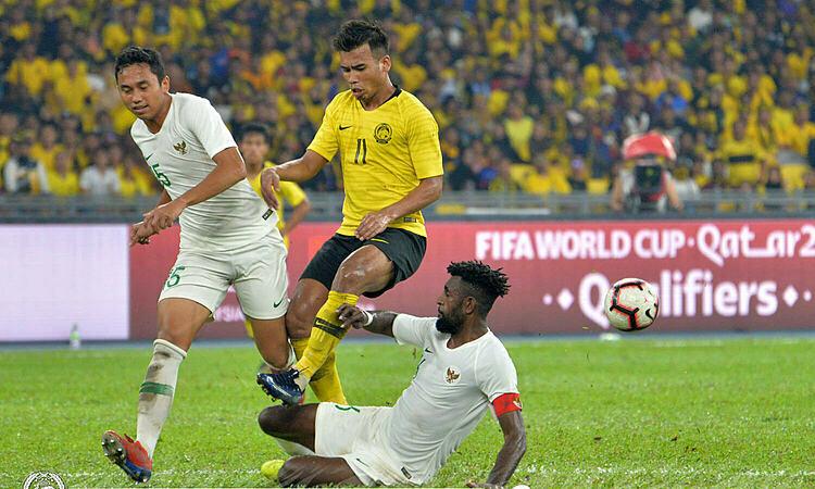 Safawi (số 11) là người hùng đội tuyển Malaysia. Ảnh: FAM.
