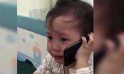 Bé gái gọi điện mách ông nội vì bị bố trêu