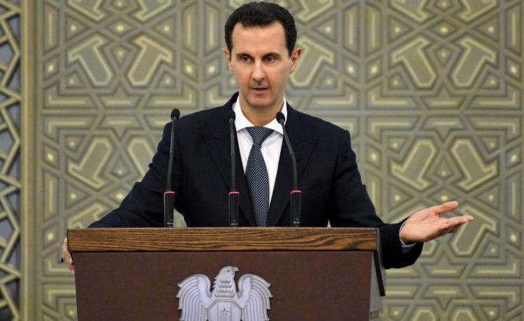 Tổng thống Syria Bashar al-Assad phát biểu trong cuộc họp ở Damascus hôm 17/2. Ảnh: Reuters.