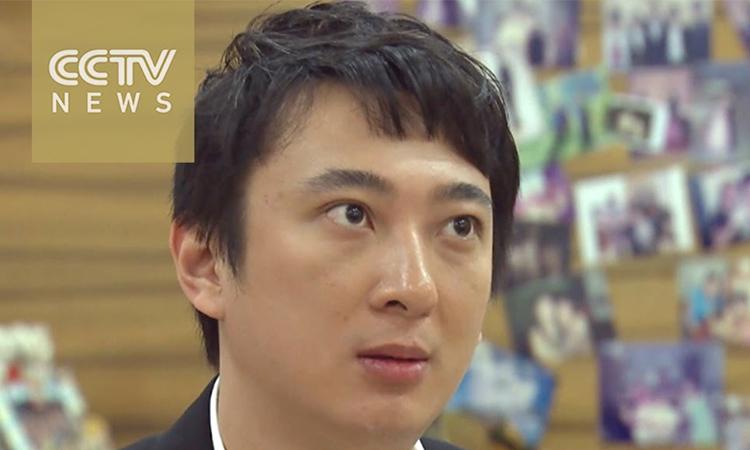 Vương Tư Thông trong một cuộc phỏng vấn với CCTV News năm 2016. Ảnh: CCTV News.