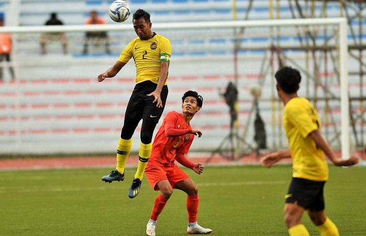 Malaysia và Myanmar chia điểm sau trận ra quâncăng thẳng tạiSEA Games. Ảnh: AFP.