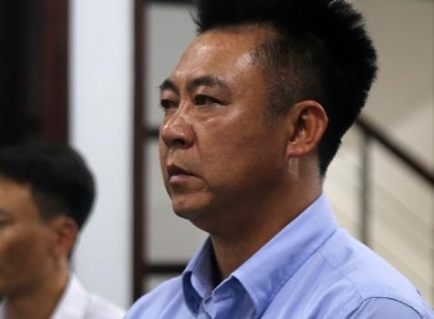 Đinh Tiến Sử tại phiên tòa ở Nha Trang. Ảnh: Xuân Ngọc.