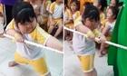 Thần thái gánh đội của bé gái khi kéo co