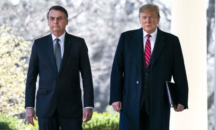 Tổng thống Mỹ Donald Trump (phải) và người đồng cấp Brazil Jair Bolsonaro tại Nhà Trắng hôm 19/3. Ảnh: AFP.