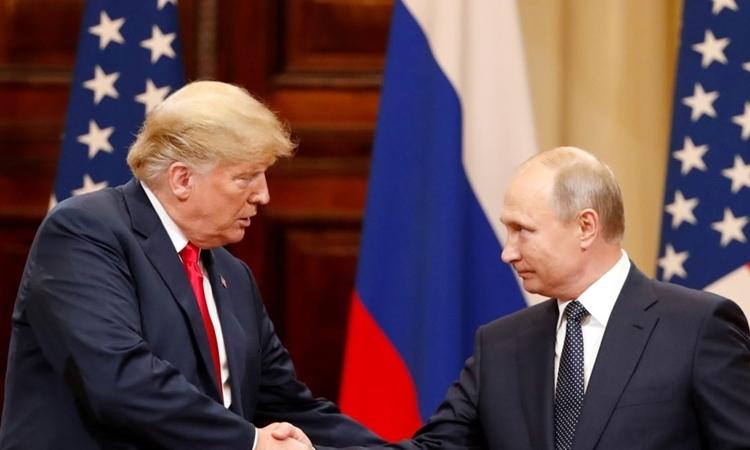 Tổng thống Mỹ Donald Trump (trái) và Tổng thống Nga Vladimir Putin tại Helsinki, Phần Lan, hồi tháng 7/2018. Ảnh: Reuters.