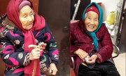Con gái 84 tuổi cười tươi khi được mẹ 107 tuổi cho kẹo