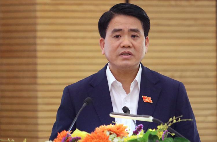 Ông Nguyễn Đức Chung trả lời cử tri quận Hoàn Kiếm chiều 6/12. Ảnh: Võ Hải.
