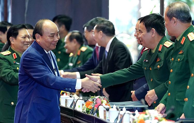 Thủ tướng Nguyễn Xuân Phúc tới dự Hội nghị quân chính toàn quân. Ảnh: TTXVN.