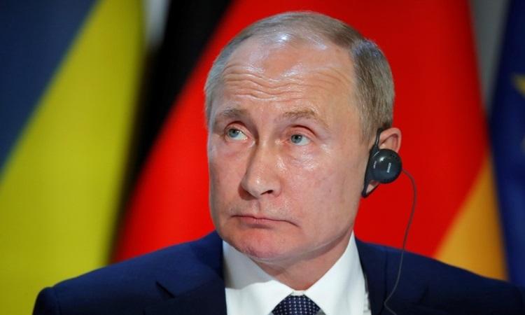 Tổng thống Nga Vladimir Putin tại buổi họp báo sau hội nghị thượng đỉnh ở Paris hôm 9/12. Ảnh: AFP.