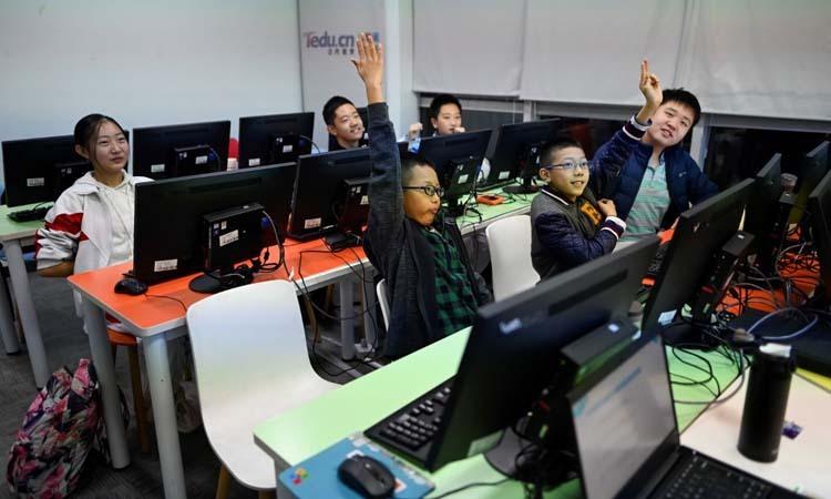 Lớp học lập trình tại một trung tâm ở thủ đô Bắc Kinh, Trung Quốc. Ảnh: AFP.