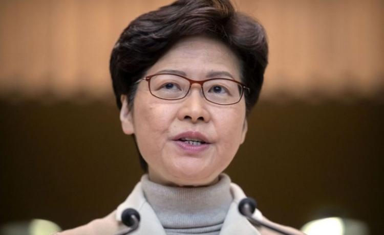 Trưởng đặc khu Hong Kong Carrie Lam trong cuộc họp báo hôm 10/12. Ảnh: AP.