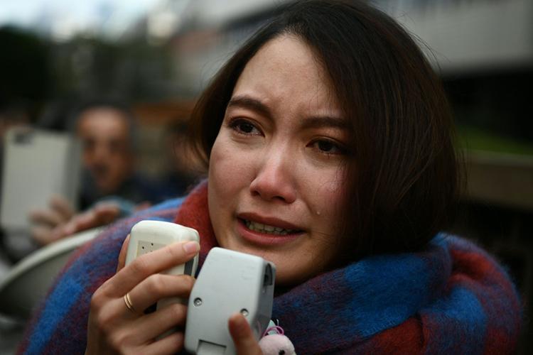 Ito khóc khi phát biểu trướcbáo chí sau khi thắng kiện. Ảnh: AFP