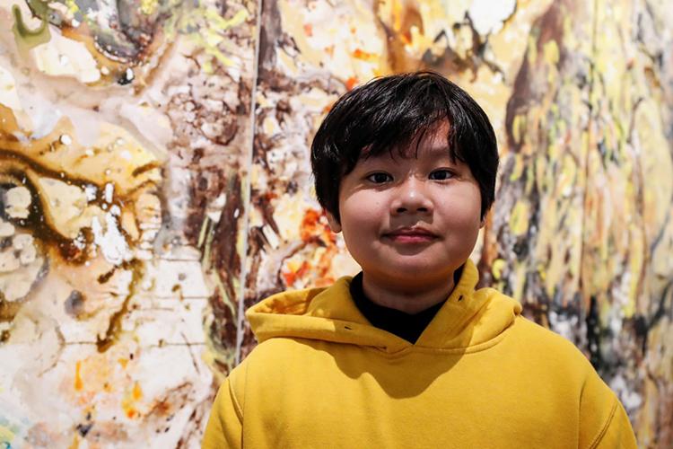 Xèo Chu tại Phòng trưng bày George Berge ởNew York hôm 18/12, trước khi khai mạc triển lãm. Ảnh: Reuters