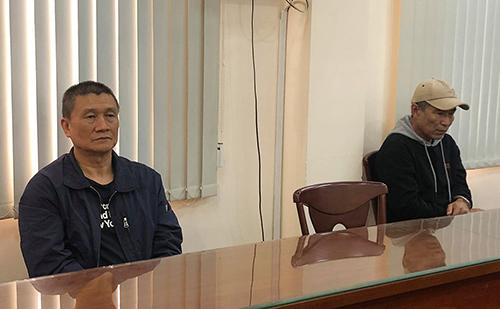 Hai nghi phạm người Đài Loan - Trung Quốc bị bắt. Ảnh: Quốc Thắng.