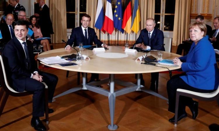 Từ trái qua: Zelensky, Macron, Putin và Merkel tại hội nghị ở Paris hôm 9/12. Ảnh: AFP.