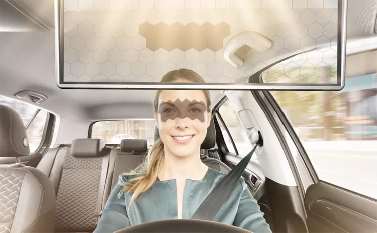 Một phần màn hình sẽ có màu tối, chặn ánh nắng chiếu vào mắt tài xế, trong khi phần còn lại vẫn trong suốt. Ảnh: Bosch