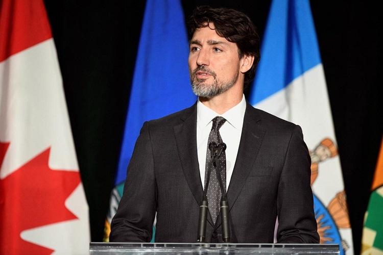 Thủ tướng Trudeau phát biểu tại lễ tưởng niệm nạn nhân vụ rơi máy bay Ukraine tại đại học Alberta, Canada hôm 12/1. Ảnh: Reuters.