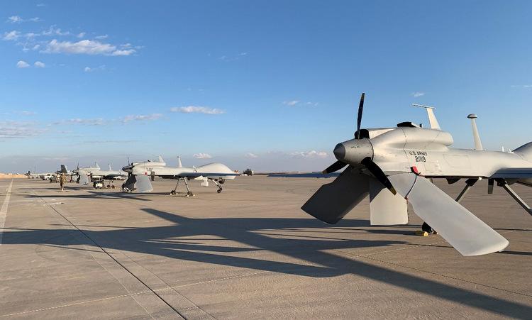 Phi đội Gray Eagle tại căn cứ Ain al-Asad hôm 13/1. Ảnh: AFP.