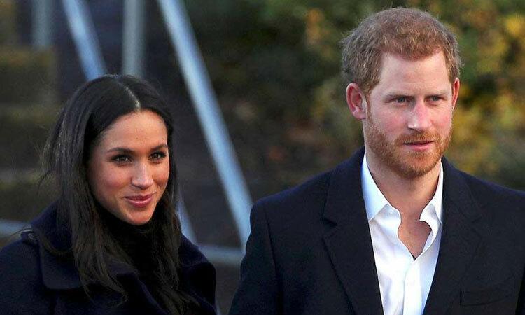 Hoàng tử Harry (phải) và Meghan. Ảnh: Reuters.