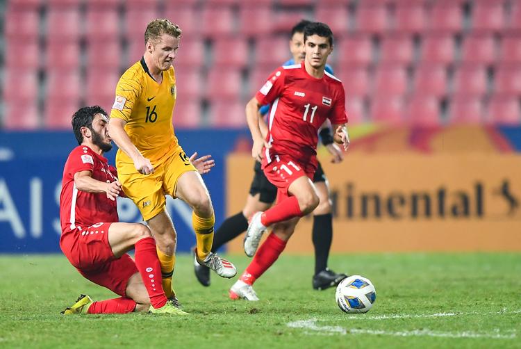 Syria chiến đấu kiên cường khiến Australia gặp nhiều khó khăn trong trận tứ kết thứ hai U23 châu Á 2010. Ảnh: AFC