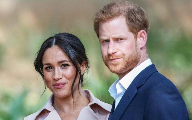 Harry và Meghan trong một chuyến thăm tới Johannesburg, Nam Phi, hồi tháng 10/2019. Ảnh: AFP.