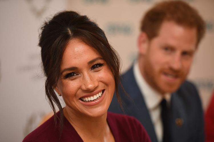 Harry - Meghan khi tham gia một cuộc thảo luận về bình đẳng giới ở thị trấn Windsor, Anh tháng 10/2019. Ảnh: AFP