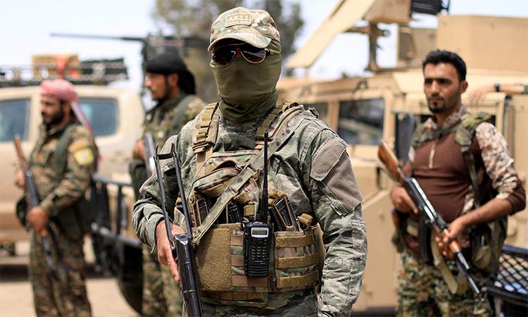 Dân quân thuộc Lực lượng Dân chủ Syria (SDF) tại tháng 5/2018. Ảnh: Reuters.