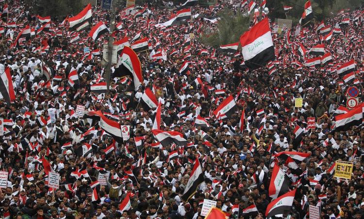 Người biểu tình phản đối Mỹ ở trung tâm Baghdad hôm 24/1. Ảnh: AFP.