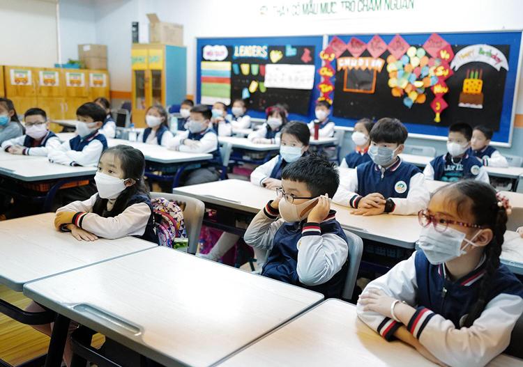 Học sinh ở Hà Nội đeo khẩu trang phòng virus corona. Ảnh: Ngọc Thành