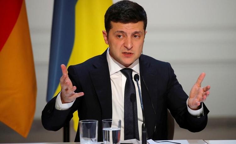 Tổng thống Ukraine Volodymyr Zelenskiy phát biểu trong cuộc họp báo ở Paris, Pháp ngày 10/12/2019. Ảnh: Reuters.