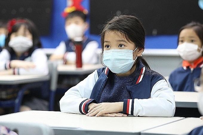Học sinh Hà Nội đeo khẩu trang trong buổi học ngày 31/1. Ảnh: Ngọc Thành