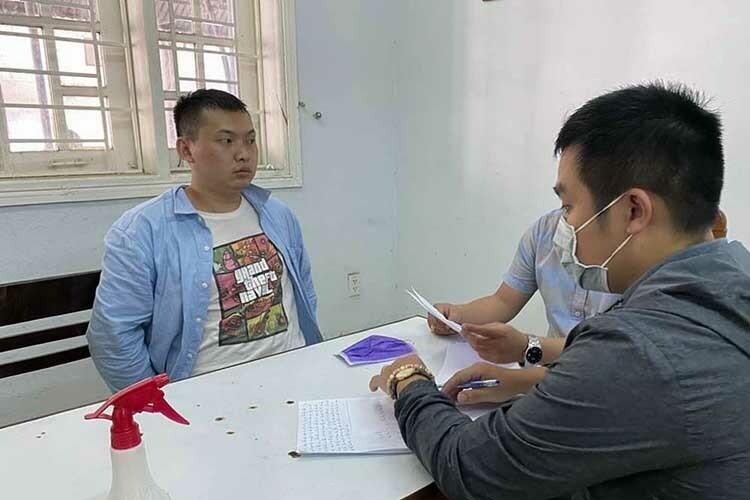 Nghi phạm Xiao Guiping tại cơ quan công an. Ảnh: B.V.