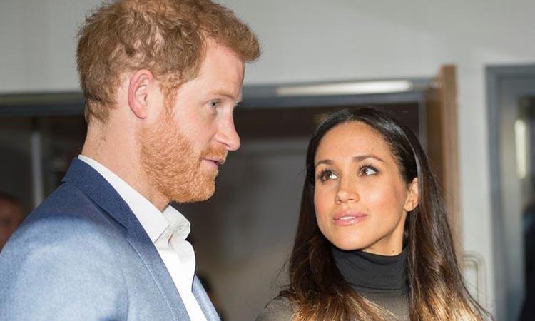 Cặp đôi Harry - Meghan ở Nottingham, Anh tháng 12/2017. Ảnh: Reuters.