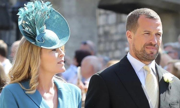 Peter Phillips và vợ Autumn tại lễ cưới Harry - Meghan hồi năm 2018. Ảnh: AFP.