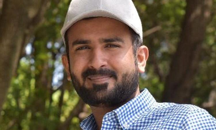 Nhà nghiên cứu người Pakistan Mir Hassan, hiện công tác tại Phòng thí nghiệm Quang điện tử Quốc gia Vũ Hán. Ảnh: Reuters.